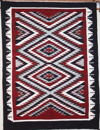 Outline rug by Navajo weaver Ella Mae Begay